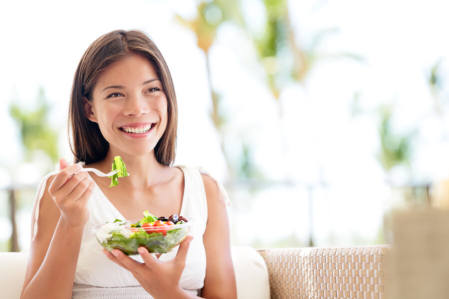 Pregnant woman eating healthy salad