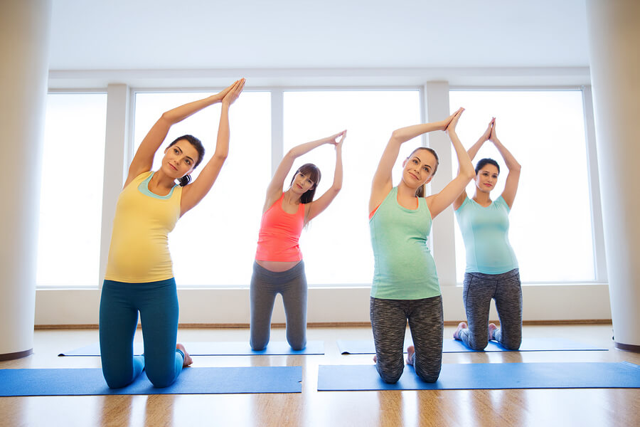 Pregnant Women In Yoga Fitness Class