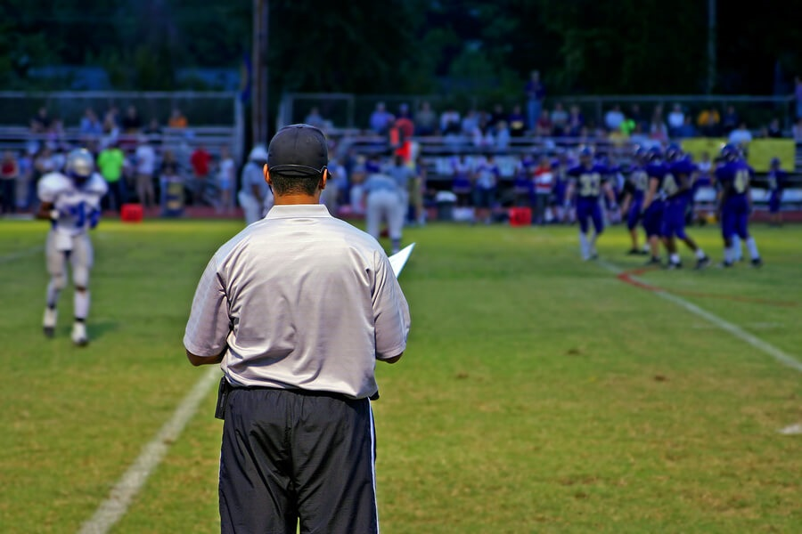 what colleges look for, football coach watching game