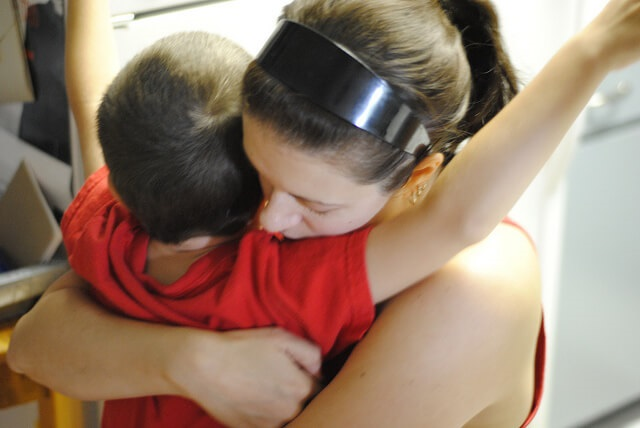 Autism Awareness Month Mom Hugging Son
