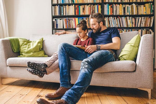 dad monitoring daughter's social media use
