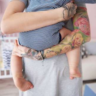 15 Meaningful Tattoo Ideas For Parents to Honor Kids