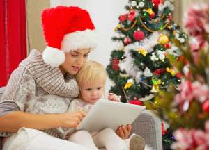 mother and child Facetime using tablet on Christmas