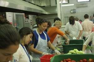 teens volunteering in soup kitchen