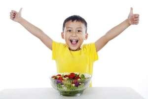 Child Eating Vegetables