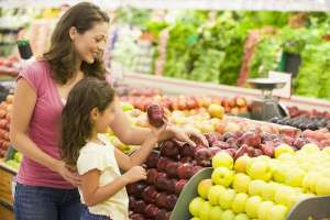 Woman and Daughter Shopping for Produce