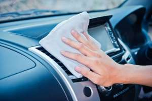 Using Rag to Clean Car Dashboard
