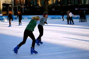 Two Tweens Ice Skating