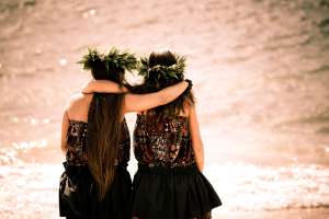Two Hawaian Girls with Arms Around Each Other