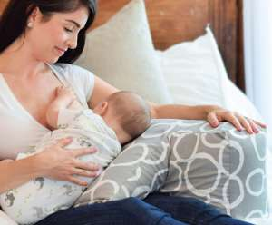 Nursing Mom Using Breastfeeding Pillow