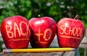 back to school gadgets - apple with back to school sign