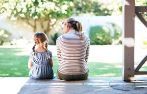 mom talking to daughter about difficult subject