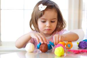 Child Playing with Homemade Clay
