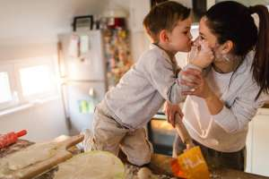 kid and mom having fun in the kitchen