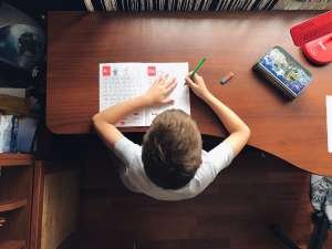 homeschooled child working on schoolwork at home