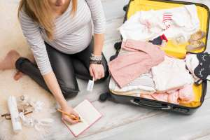 pregnant woman making a third trimester to-do list
