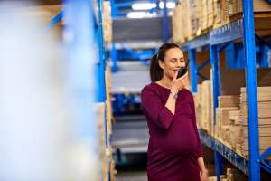 pregnant woman working at a physically strenuous job