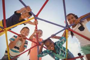diverse group of kids on playground