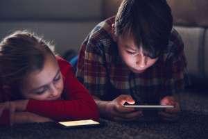 kids starting at phones
