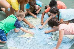 kids doing earth day crafts with chalk