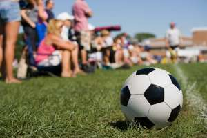 parents on sideline at kids soccer game