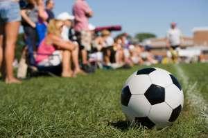 parents on sideline at kids soccer game