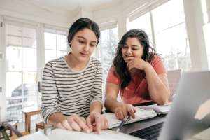 mom helping teen choose a college