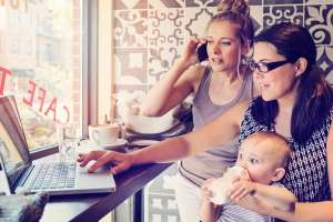 working moms in cafe with baby