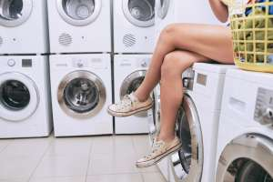 Teen doing their laundry