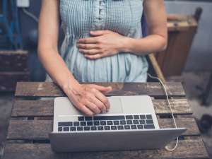 pregnant woman browsing online community