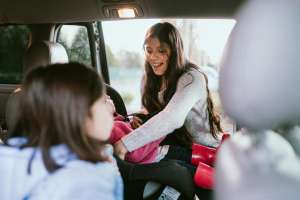 mom packing family into minivan