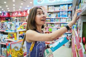 woman shopping for top toys for kids