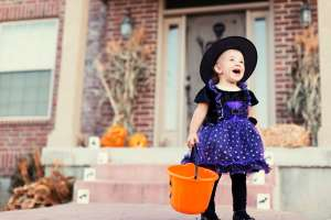 Baby Girl Dressed Up in Witch Halloween Costume Spooky Vampire/Witch Names of 2019