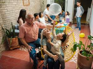Family spending time with each other and playing with balloons at family reunion