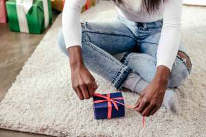 teen girl opening stocking stuffer gift