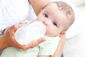 bottle feeding a baby
