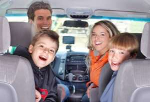 Smiling Happy Family in Car