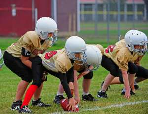 Young football players line of scrimmage