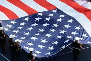 Supporting Our Troops, troops in uniform holding giant US flag