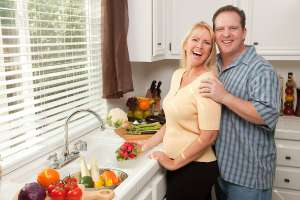 Keeping Your Husband Healthy, Married couple cooking heart healthy meal for mans diet