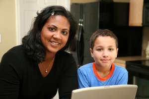 ADHD tips for parents, mother and son using laptop