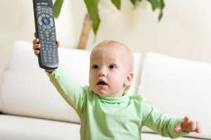 what is the right age, baby with TV remote