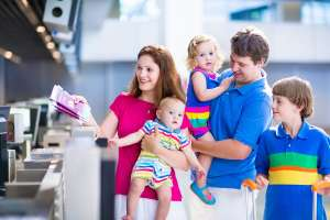 family with baby and toddler at airport