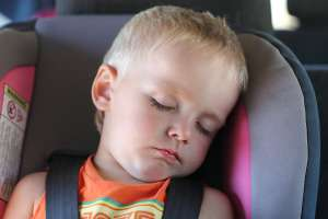 baby sleeping in car