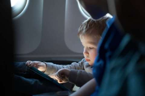 Child Using TAblet on Plane