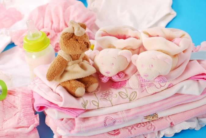 Pile of pink baby supplies