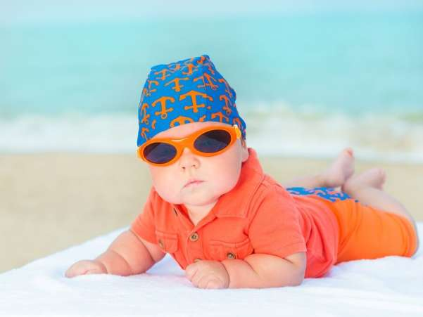 Baby wearing sunglasses at the beach