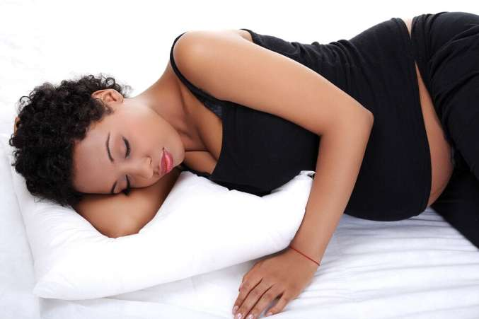 Pregnant woman in bed sleeping