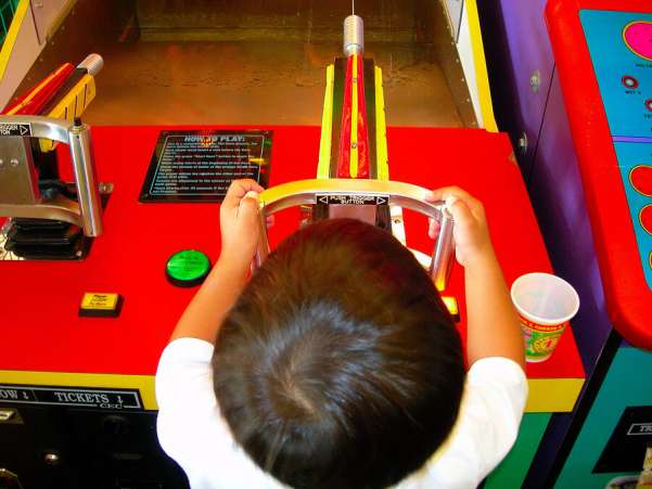 BoyPlayingintheArcade,Game