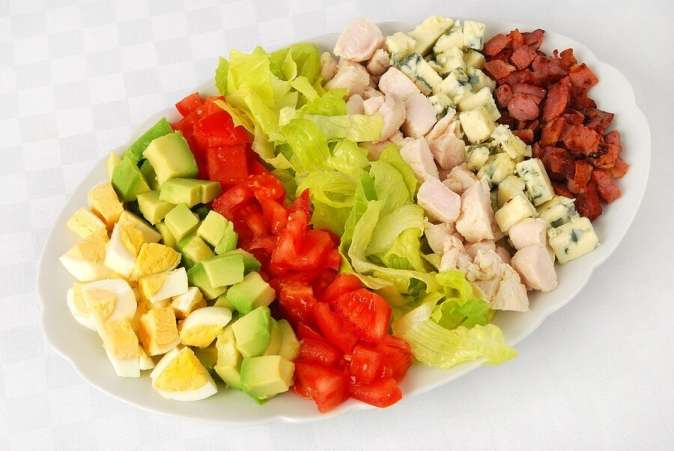 Prepared cobb salad on white background
